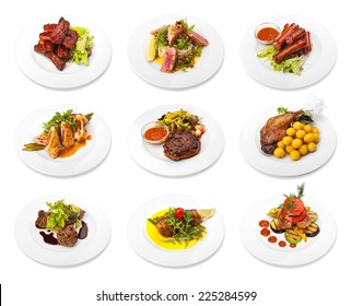 Collection of meat dishes on white plates. Isolated on white background
