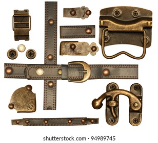 Collection of metal and leather elements for scrapbooking design. Isolated over white