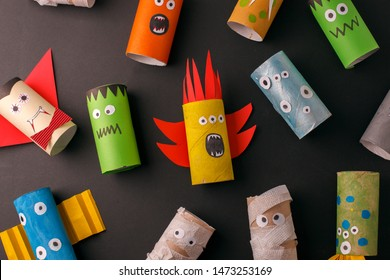 Collection of Monsters from toilet tube roll for halloween decor. A terrible craft. School and kindergarten. Handcraft creative idea, seasonal autumn holiday pattern