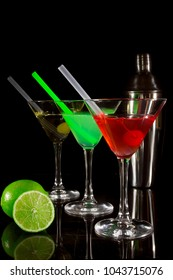 Collection of multi-colored cocktails on a black background