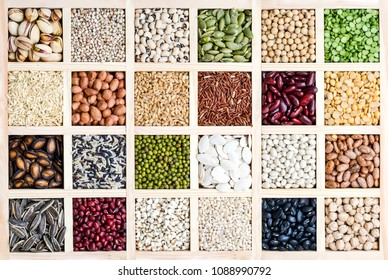 The collection of natural cereal grain seeds in wooden box, for carbohydrate food and agricultural product concept