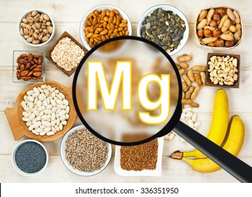 Collection natural products containing magnesium - pumpkin seeds, poppy seed, cashew nuts, beans, raw cocoa beans, almonds, sunflower seeds, oatmeal. buckwheat, peanuts, hazelnuts, pistachios, banana