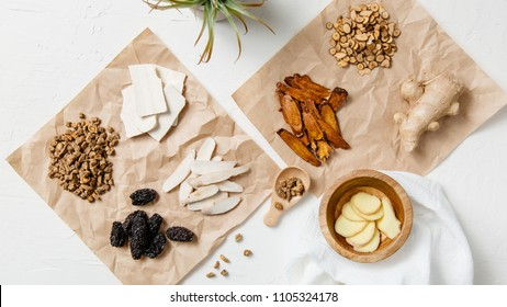 A collection of natural raw herbal ingredients as part of an herbal tonic formula used in Traditional Chinese Medicine (TCM) for cold and flu. - Shutterstock ID 1105324178