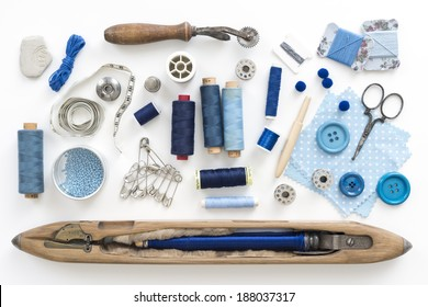 a collection needle work accessories in blue on white background