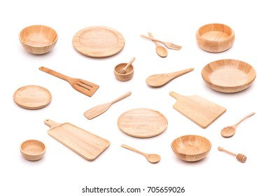 Collection of new wooden kitchen utensil, bowl, plate, spoon, dish. Studio shot isolated on white background
