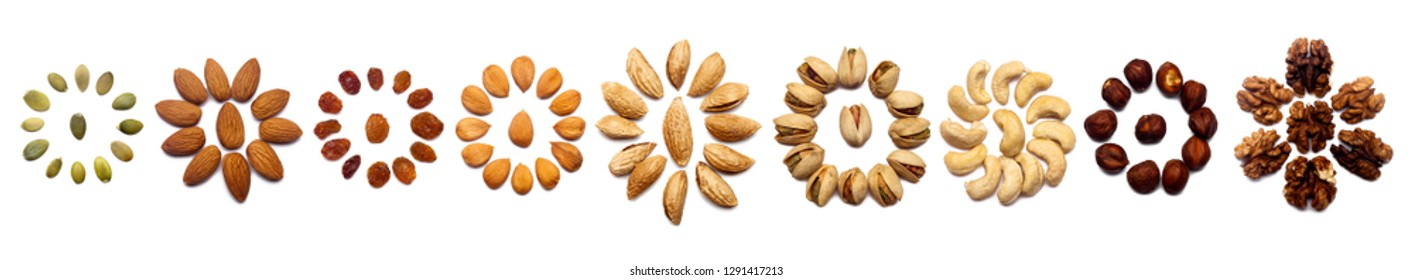 A collection of nuts made from almonds, walnuts, hazelnuts, pistachios, cashews lie in the shape of a circle or the sun on an isolated white background with a clipping path. Various nuts pattern