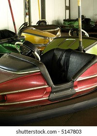 A collection of old bumper cars at an old amusement park