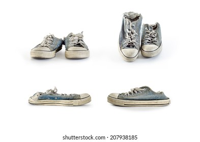 Collection of old dirty sneakers on a white background