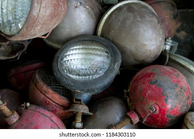 Collection of old tractor headlights and lamps