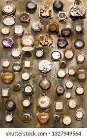 collection of old watches on grunge background