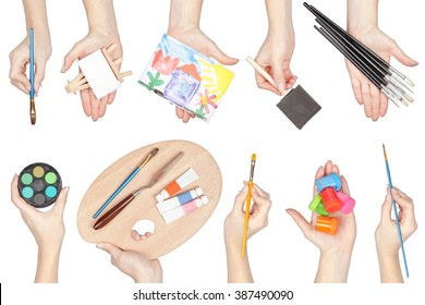 collection of painting equipment in a hands isolated on white background