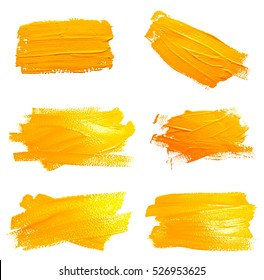 Collection of photos yellow ochre strokes of the paint brush isolated on a white