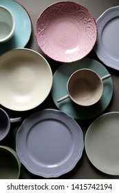 Collection of pottery and kitchenware in muted pastel colors. Top view.
