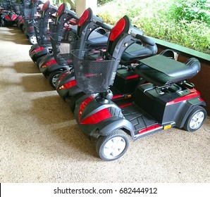A collection of power mobility scooters with four wheels for the convenience of the elderly.