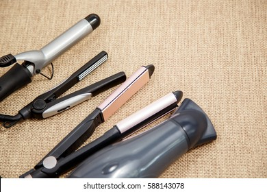 Collection of the professional hairdresser appliances - hair dryer, curling, corrugation, straightener