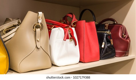 collection of purses in woman`s closet