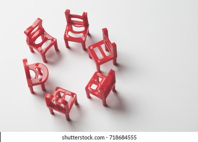 Collection of red chairs in a circle. Job opportunity. councelling. recruitment concept.