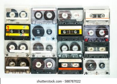 Collection of retro audio cassettes on white background, vintage tapes