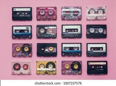 Collection Of Retro Audio Tapes In Row  On Lilac Background. Retro Technology Music Concept
