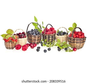 Collection of ripe wild berries mix in the basket isolated on white background