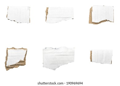 collection of ripped  white pieces of cardboard, no shadows, isolated on white.