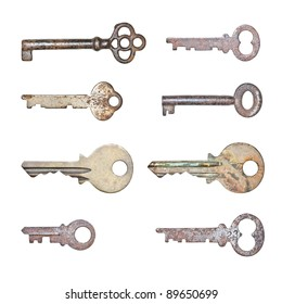 A collection of rusty old keys in isolated white background
