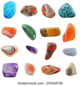 A collection of semi-precious stones against white background