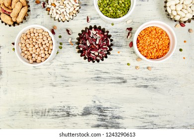 Collection set of beans and legumes red turkish lentils, chickpeas, beans, peanuts, peas, canadian lentils on white background. Bowls of various lentils. Top view. Copy space.