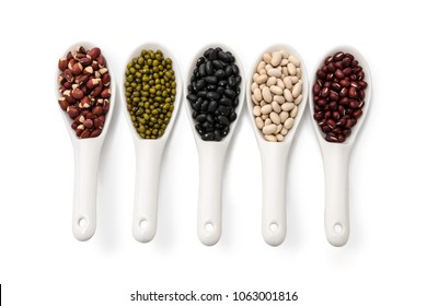 Collection set kinds of five beans in ceramic spoon isolated on white background for natural grains consisted, Red Cowpea, Red Azuki, Green, White and Black bean. Top view