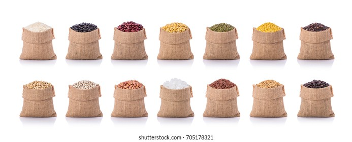 Collection of several beans, rice, coffee in small sack. Studio shot isolated on white background