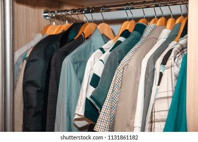 collection of shirts in the wardrobe