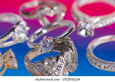 Collection of silver rings on a colored background.