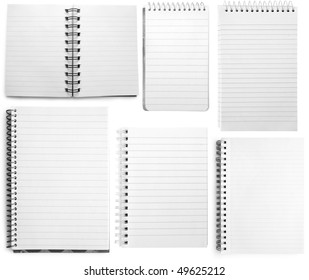 Collection  of six white notebooks isolated on white background