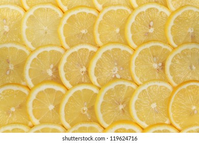 Collection of sliced lemons forming a background