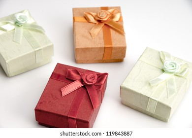 Collection of small red, green, and orange gift boxes