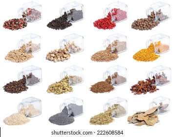 Collection of spices and herbs scattered on white background in glass bottles