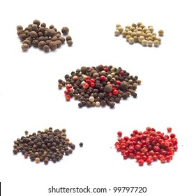Collection of spices isolated on white: Allspice, Black and White pepper, Pink peppercorn