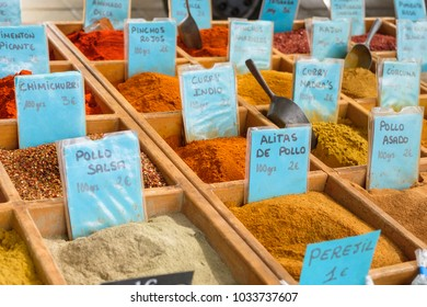 Collection of spices for sale at a market.