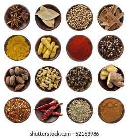 Collection of spices. Star anise, bay leaves, coriander seeds, cinnamon bark, curry powder, turmeric fingers, paprika, peppercorns, black cardamom pods, cardamom seeds, cloves, ginger root, chili fla