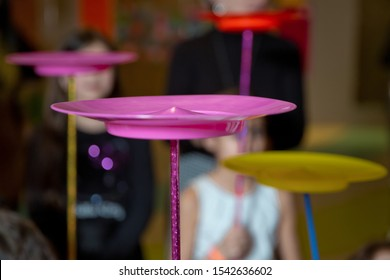 A collection of spinning pink plates . Fun with Spinning Plates .balancing a spinning plate.