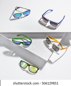 Collection of sunglasses in a stylish arrangement.