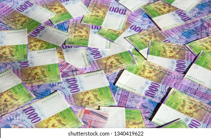 Collection of the Swiss 1000 franks banknotes. 1000 franks note issued by Swiss National Bank (SNB) is one of the most valueable banknotes in the world. The current 1000s are in circulution since 1995