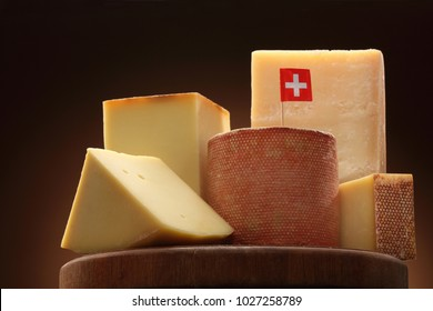 Collection of Swiss cheeses on a cheese board / Appenzeller / Gruyer/ Emmental / Edam