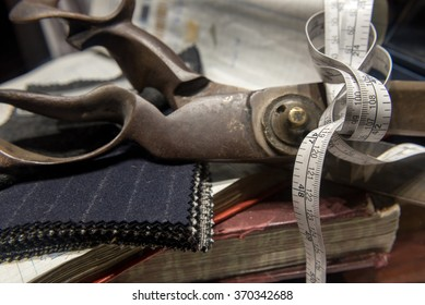 Collection of Tailors Scissors, Suit Cloth, Tape Measure and Books Together.