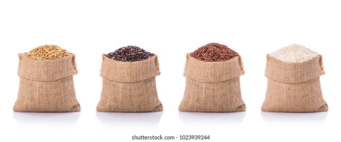 Collection of Thai rice in brown small sack. Studio shot isolated on white background