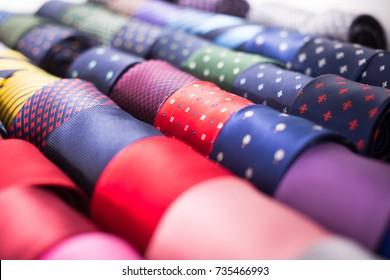 collection of ties on hangers in men clothing store