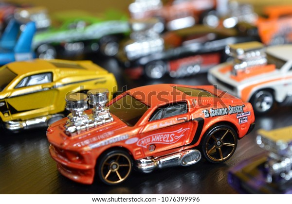 Collection of toy cars, Hot Wheels with bokeh background. Hot Wheels is a scale die-cast toy cars by American toy maker Mattel - 2018 Curitiba-Pr Brazil