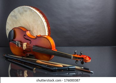A collection of traditional Irish musical instruments on a black background