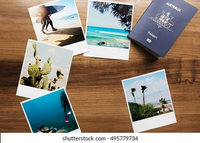 Collection of travel photographs and Australian passport flat lay