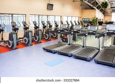 Collection of treadmills and exercise bikes at the gym
